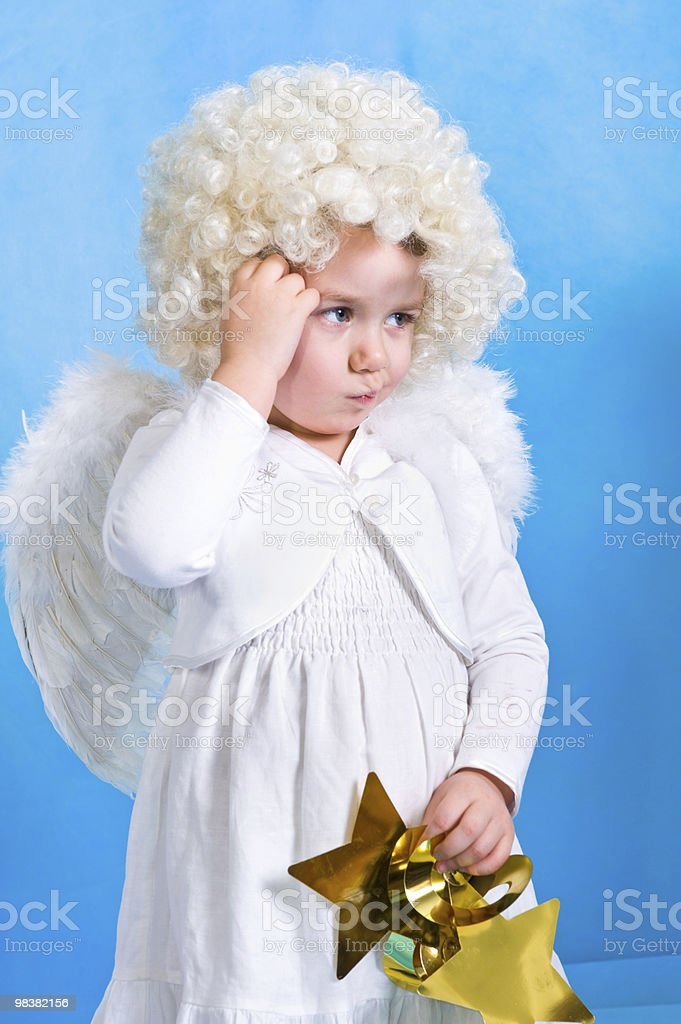 Angel with star background in blue tonality royalty-free stock photo