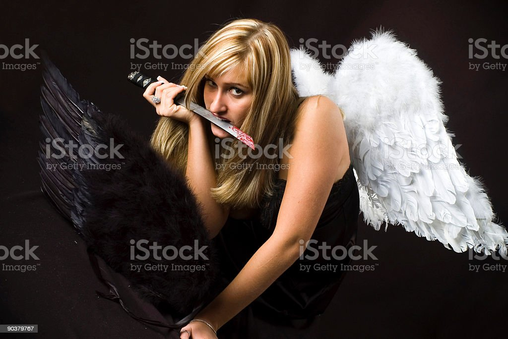 angel with steel sword and one more wings royalty-free stock photo