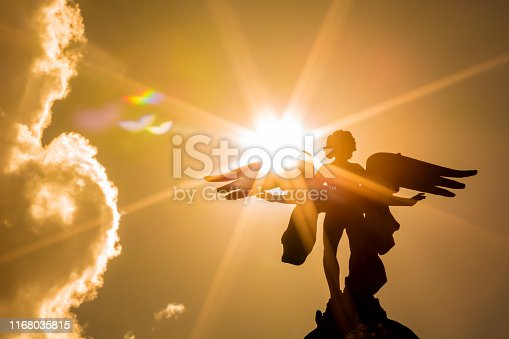 Angel with sunbeams