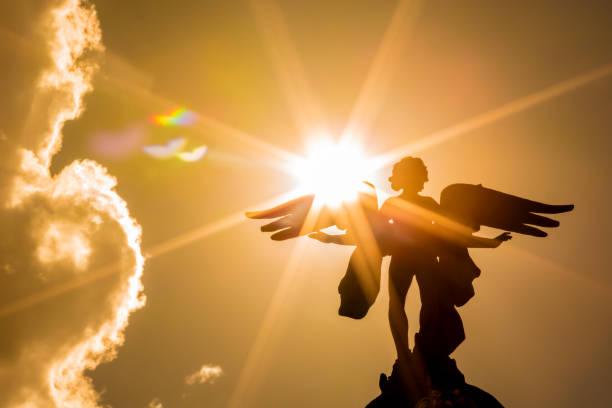 Angel with sunbeams stock photo