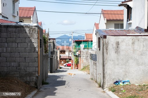 Paved road in large Pampanga subdivision with a view of Mt. Arayat (volcano) in the distance - Angeles City, Pampanga, Luzon, Philippines