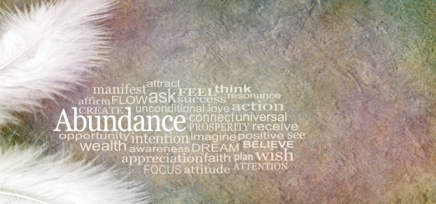 Angelic Abundance Word Cloud Two white feathers and an ABUNDANCE word cloud against a rustic subtle colored stone effect  background with copy space abundance stock pictures, royalty-free photos & images