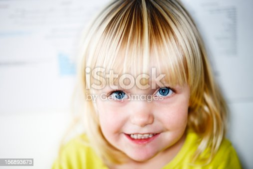 istock Angelic blonde toddler smiles shyly 156893673