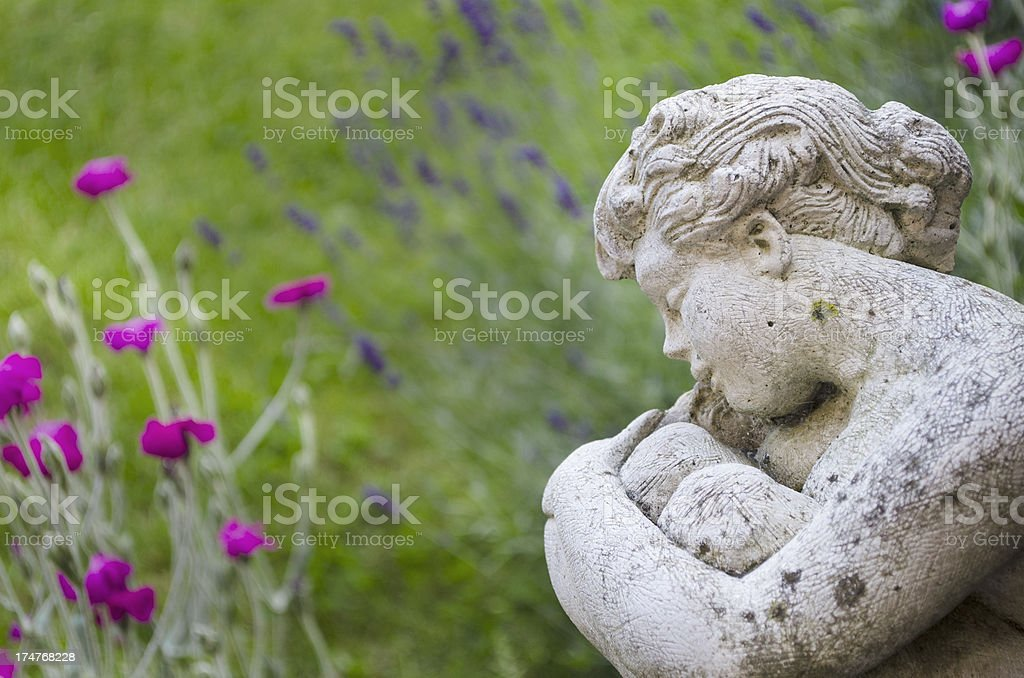 angelic garden statue stock photo