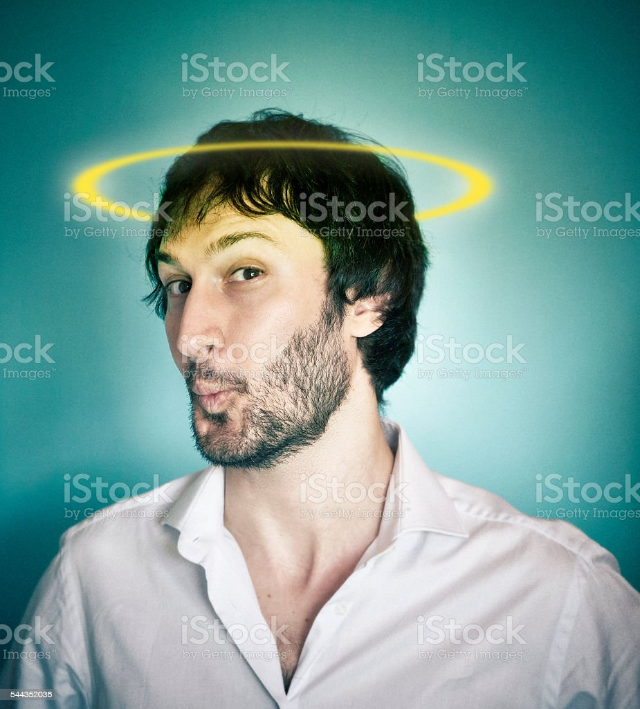 Angelic man with a halo on the head stock photo