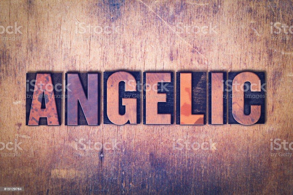 Angelic Theme Letterpress Word on Wood Background stock photo