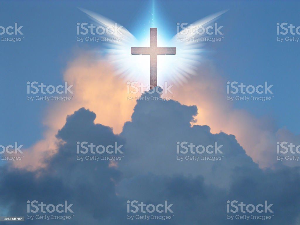 Angelic wings open before cross stock photo
