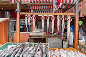 Puerto Montt,Chile - October 21, 2018: Vendors are selling seafood at Fish Market in Puerto Montt port city, Chile. Really a beautiful place, very good for tourists who are going to know part of southern Chile. You can find in the market a great variety of fruits, vegetables, seafood and smoked seafood, Also crafts, clothing and much more.