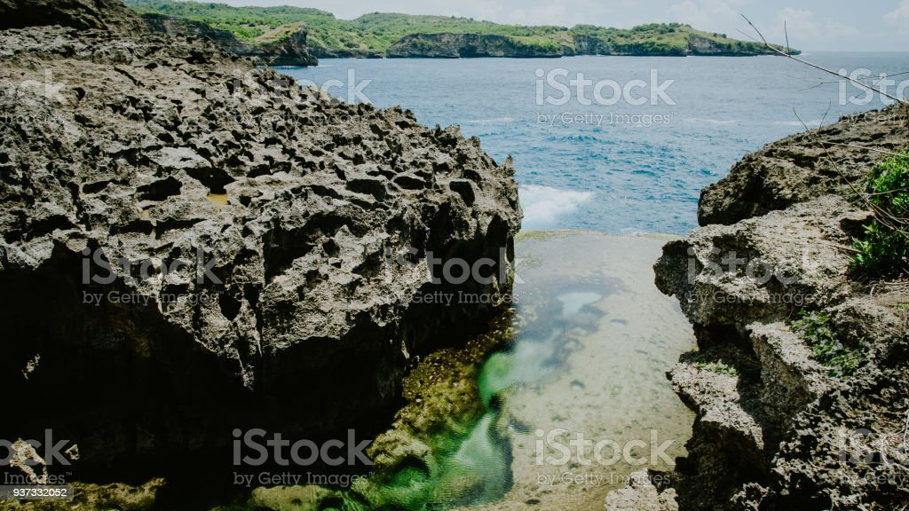 Angels Billabong, beautiful Cliff Formation with Yellow Pool, Bizarre Place, Nusa Penida Bali Indonesia stock photo