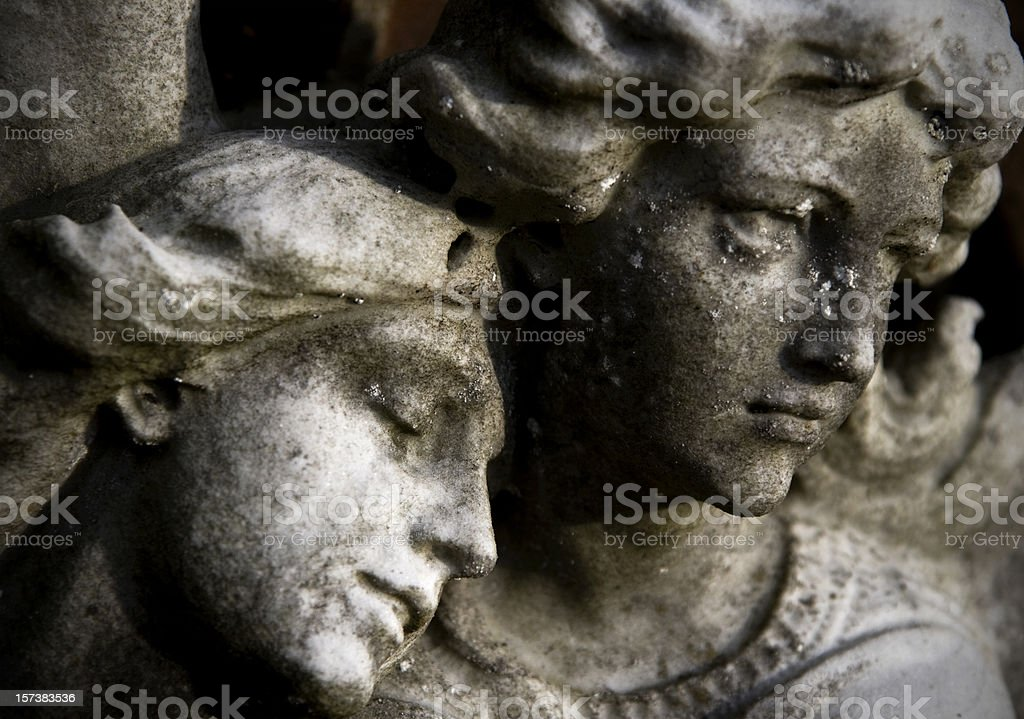Angels' faces carved in stone stock photo