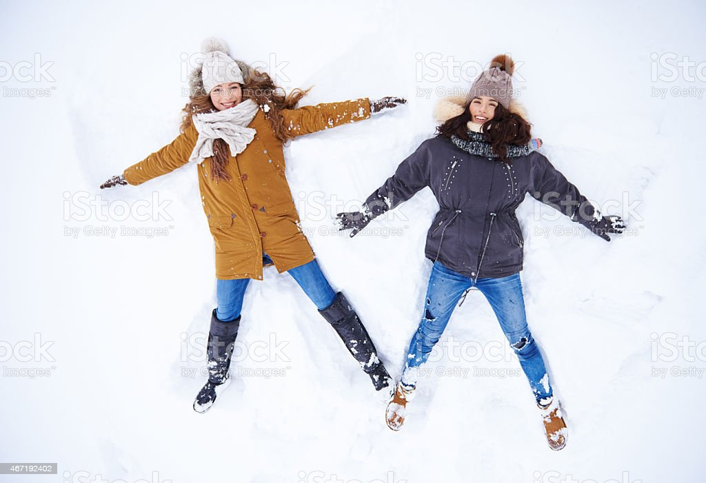 Angels in the snow stock photo
