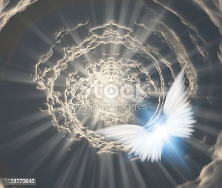 istock Angels in tunnel of clouds 1128270643