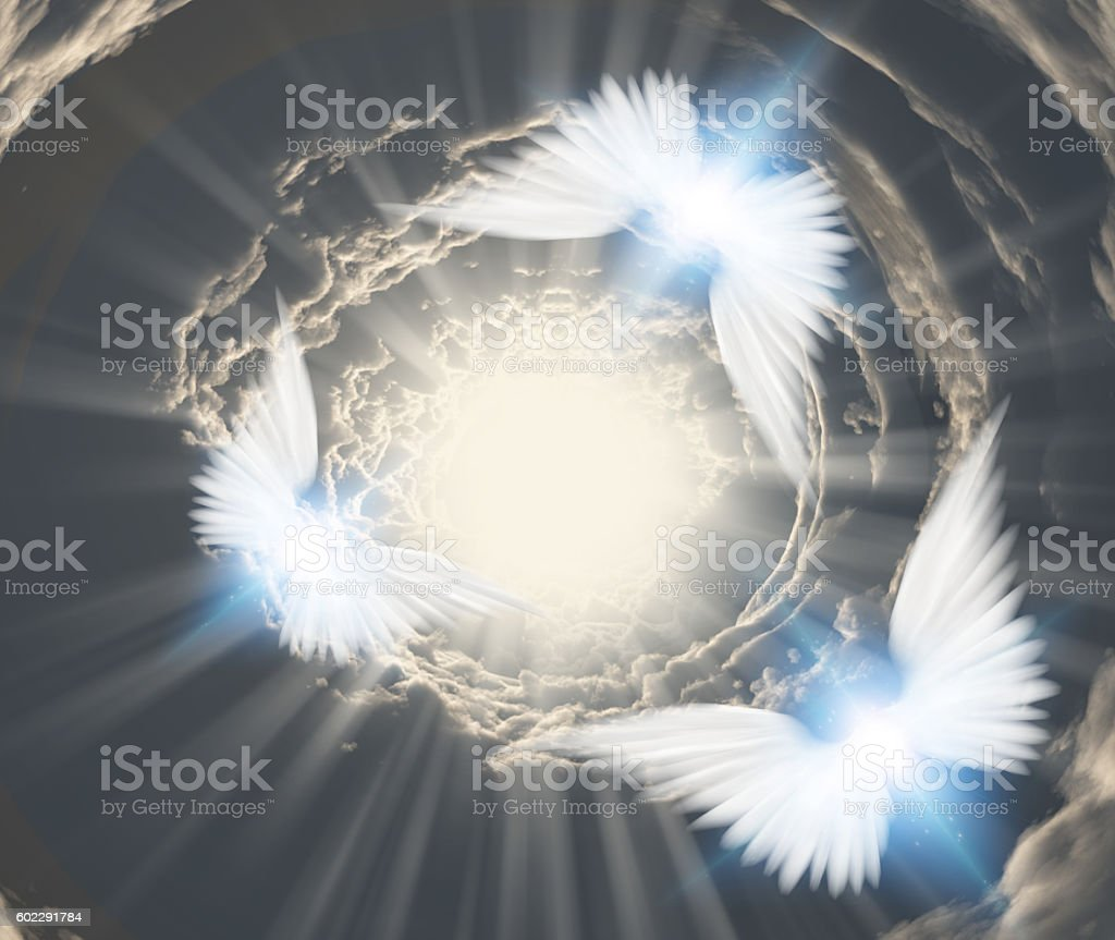 Angels in tunnel of clouds stock photo