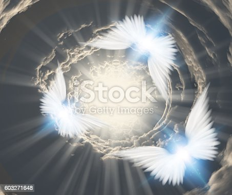 istock Angels in tunnel of clouds 603271648