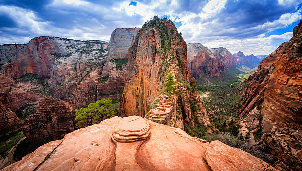 Angels Landing - Zion National Park The final precarious section of the hiking trail to Angels Landing in Zion National Park, Utah. Angels Landing is at the top of the red sandstone cliffs in the centre of the picture and provides views of the whole of Zion Canyon. theasis stock pictures, royalty-free photos & images