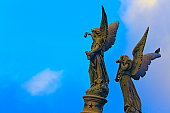 istock Angels looking to skies at dramatic evening, Recoleta Cemetery 589453562