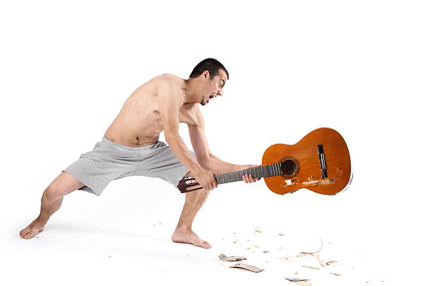 anger management - broken guitar stock photos and pictures