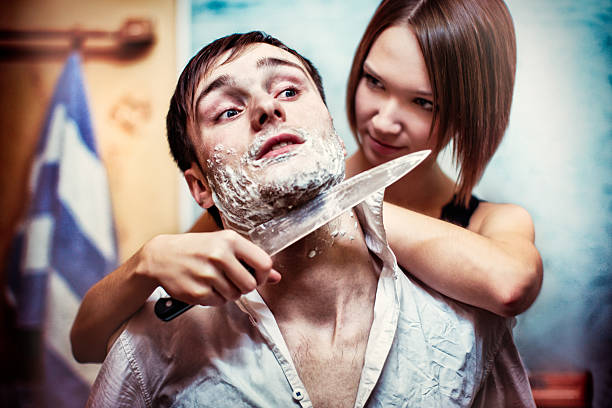angered girl with a knife shaves frightened man - knife wound stock photos and pictures