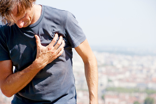 A male person, having an angina pecoris or a heart attack. XXL size image.