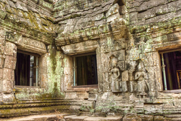 Angkor Prohm Khmer ancient Buddhist temple in jungle forest. Famous stock photo