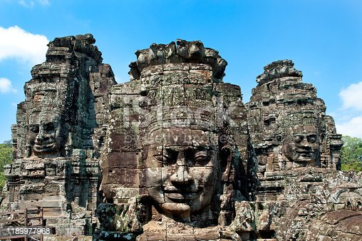 Male, female and devil gods' heads constructed from massive sculpted stone blocks at Angkor Thom, the twelfth century Khmer city at Siem Reap, Cambodia