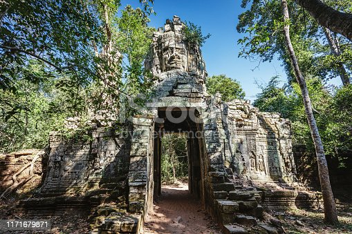 Impressive Old Stone Entrance with Stone Sculpture on Top of the Gate at Angkor Thom. Angkor Thom, Angkor Wat, Cambodia, South East Asia.