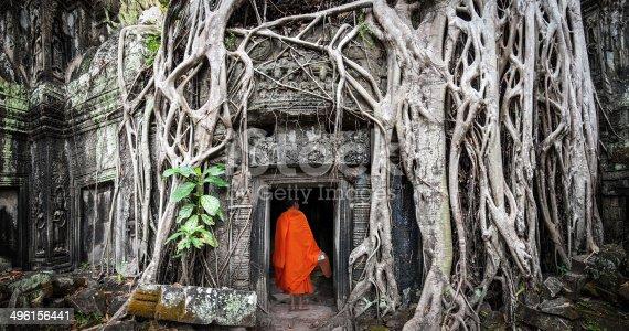 istock Angkor Wat monk. Ta Prom Khmer ancient Buddhist temple 496156441