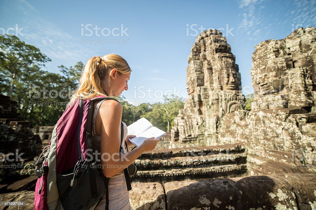 Bayon temple, Angkor Thom, Siem Reap, Cambodia - Tourist woman with...