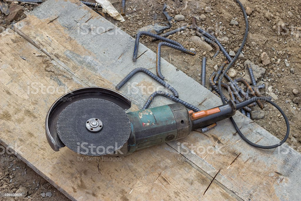 Angle grinder after cutting spacer for the rebar 2 stock photo
