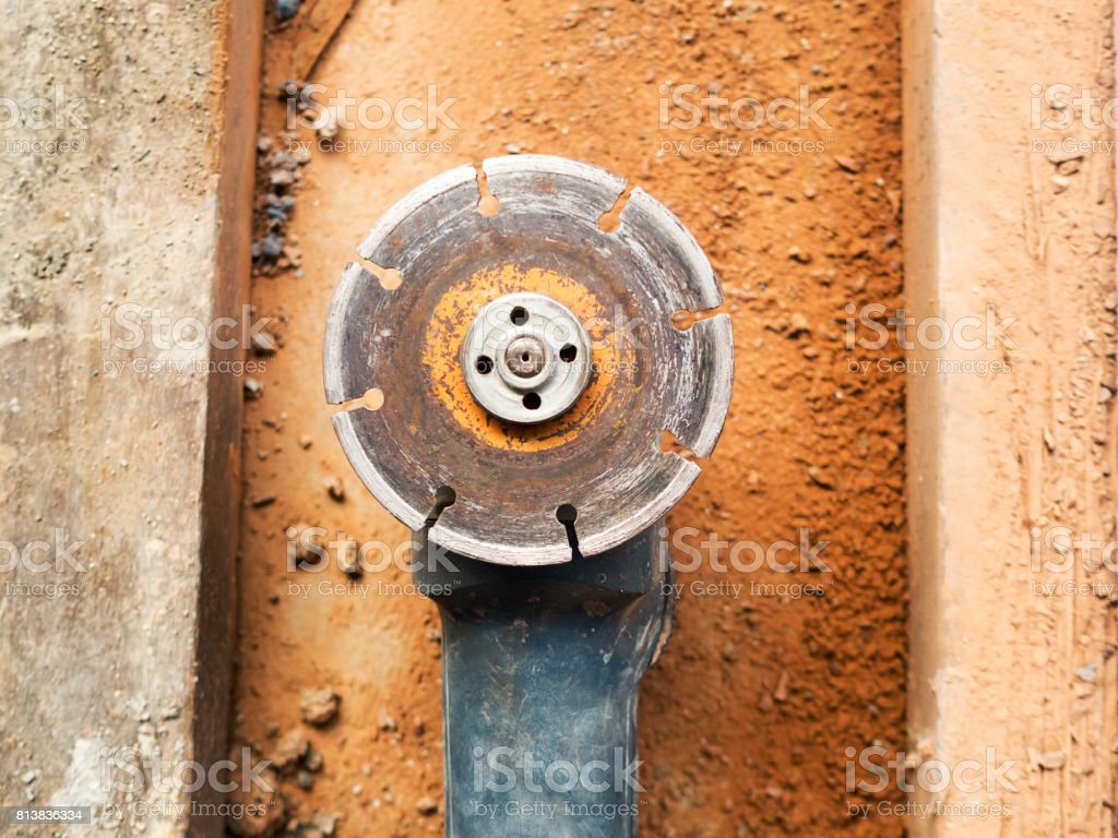 Angle grinder with diamond blade wheel for cutting tile. stock photo