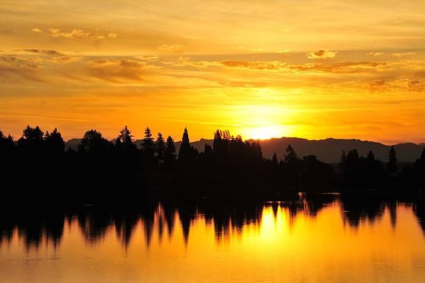 angle lake sunrise stock photo
