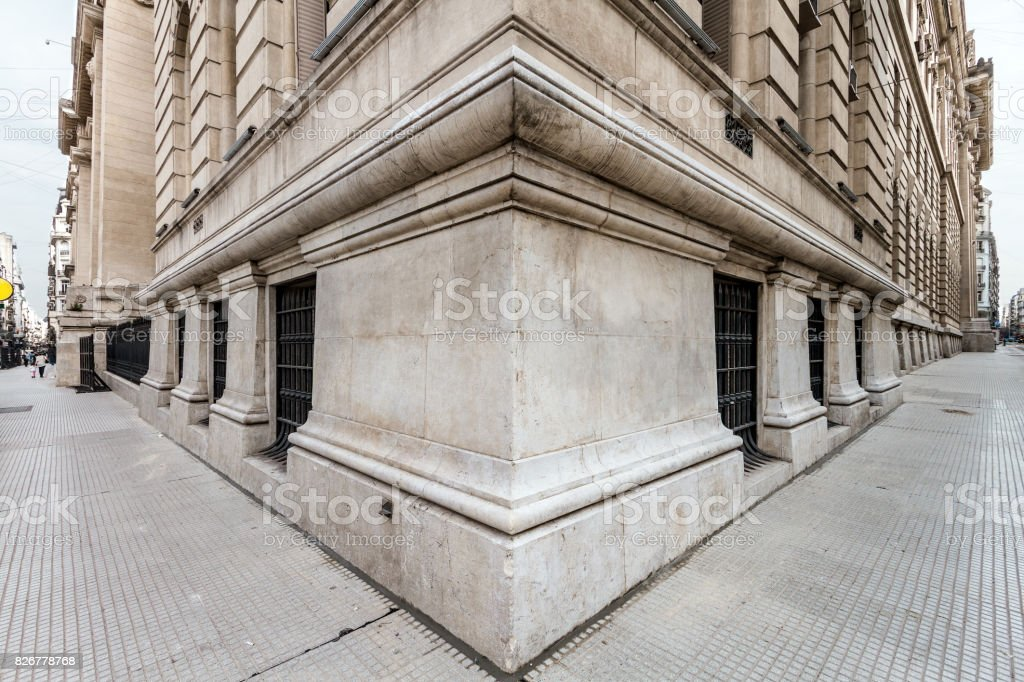 Angle of the corner of a neoclassical building with both sidewalks stock photo