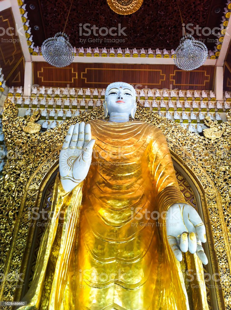 angle shot of golden Buddha statue at Burmanese temple stock photo