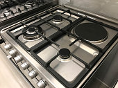 Angle view of gas modern stove and electric oven, interior design
