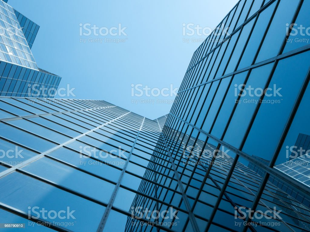 Angle view of modern building with a clear blue sky in background stock photo