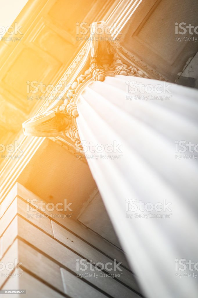 Angled Classic Courthouse Column Building At Sunset Up View stock photo