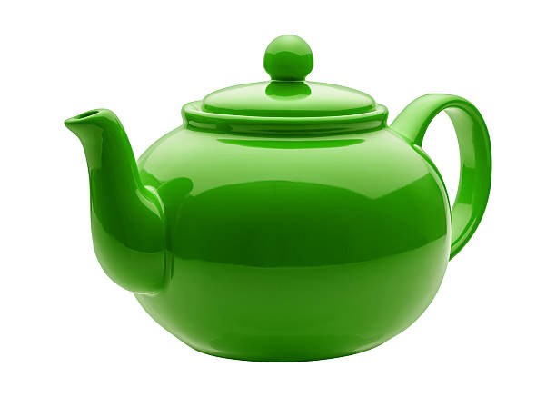 Angled Green Teapot with clipping path Green Ceramic Teapot photographed at a slight angle. The lighting is soft, and comes from a gigantic soft box directly above the teapot. The ceramic finish is highly reflective.  The teapot lid has a ball that serves as a handle for lifting it up.  The spout faces the viewer. The subject is a cut out, and is isolated on a white background. The image is in full focus, from the front to the back, achieved by stacking multiple exposures. teapot stock pictures, royalty-free photos & images