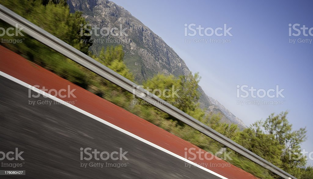 Angled motion blur shot of road royalty-free stock photo