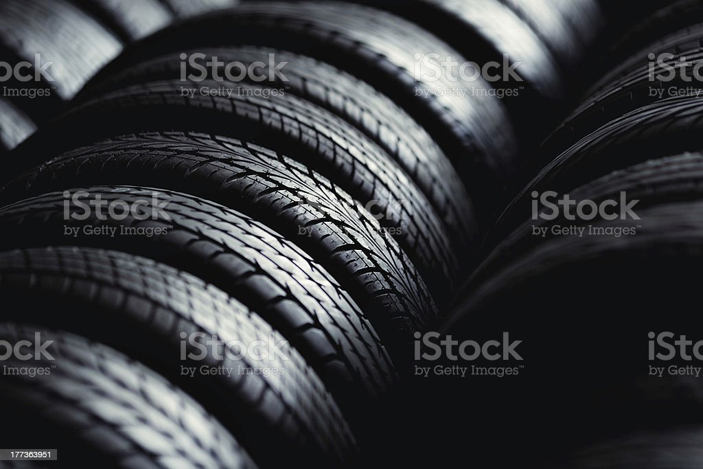 Angled photo of stacks of different patterned tires stock photo