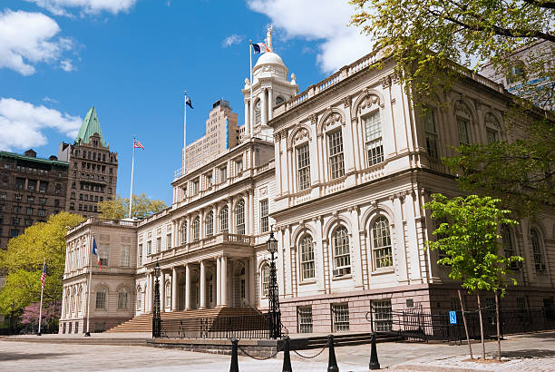angled photo of the front of city hall in manhattan - stadshus bildbanksfoton och bilder