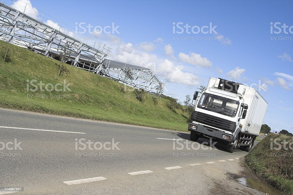 Angled Shot Of Delivery Lorry Travelling At Speed stock photo