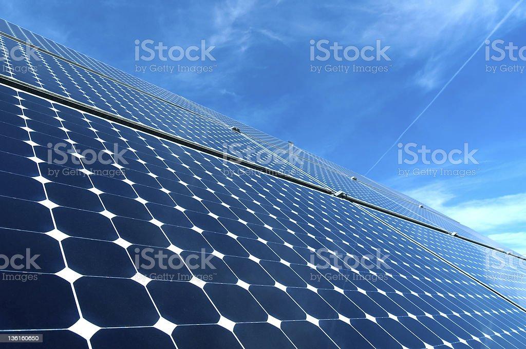 Angled solar panels under blue sky royalty-free stock photo