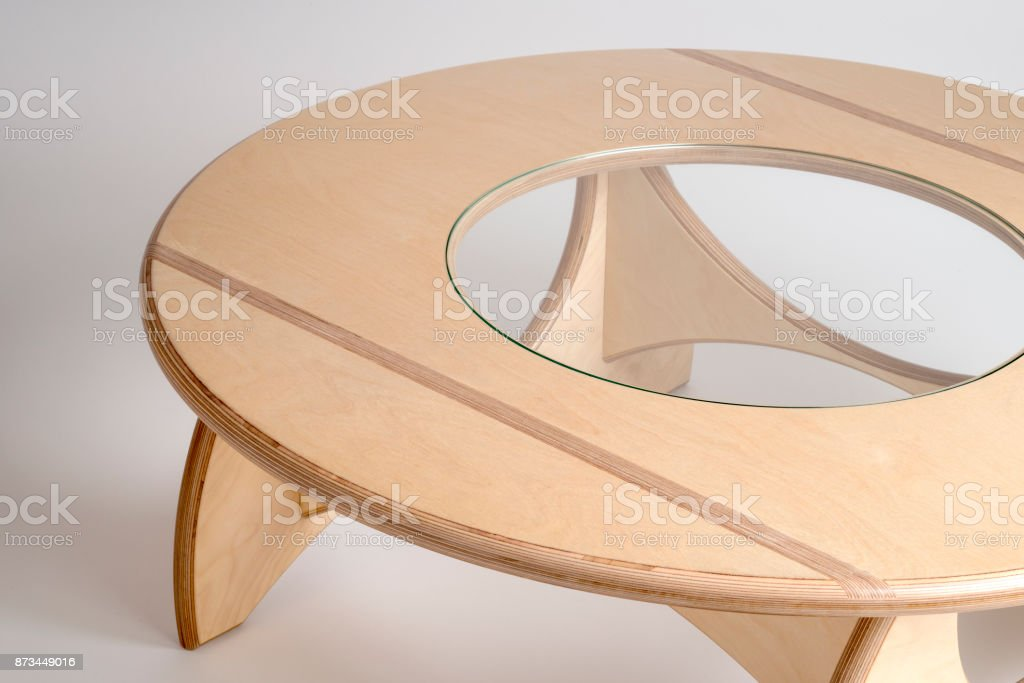 Angled Top View of Bare Wood Designer Round Table stock photo