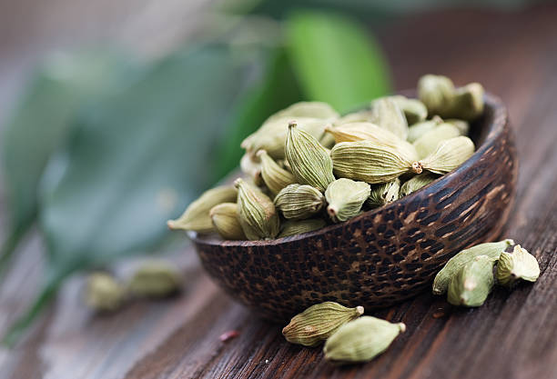 Angled view of cardamom spices in wooden bowl Cardamon Spices.Selective focus. cardamom stock pictures, royalty-free photos & images
