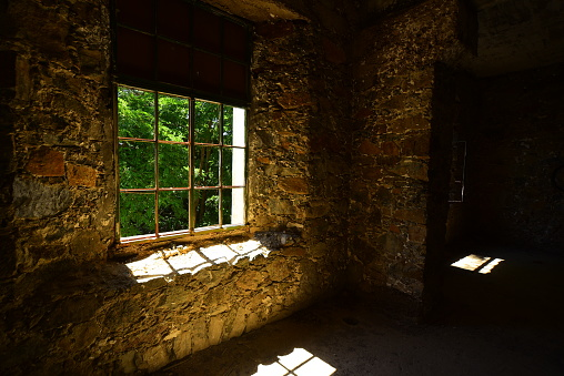 Wide shot through broken window frames in building ruins. Photo taken at the Berengaria hotel in Cyprus. Nikon D750 with Sigma 12-24mm zoom lens