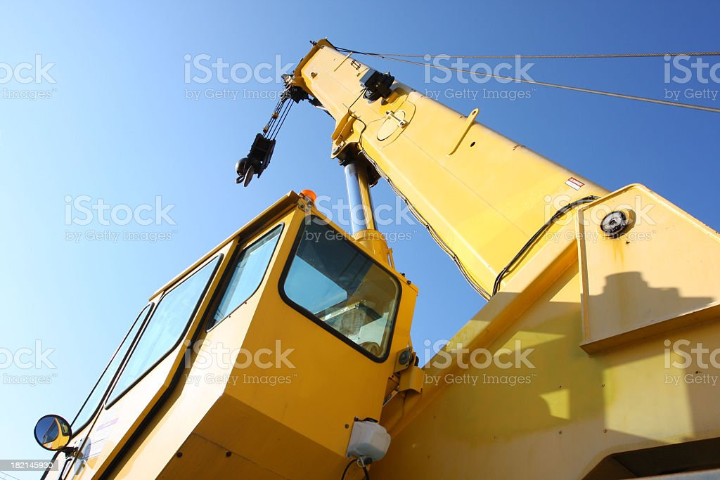 Angled view of yellow mobile construction crane against sky royalty-free stock photo