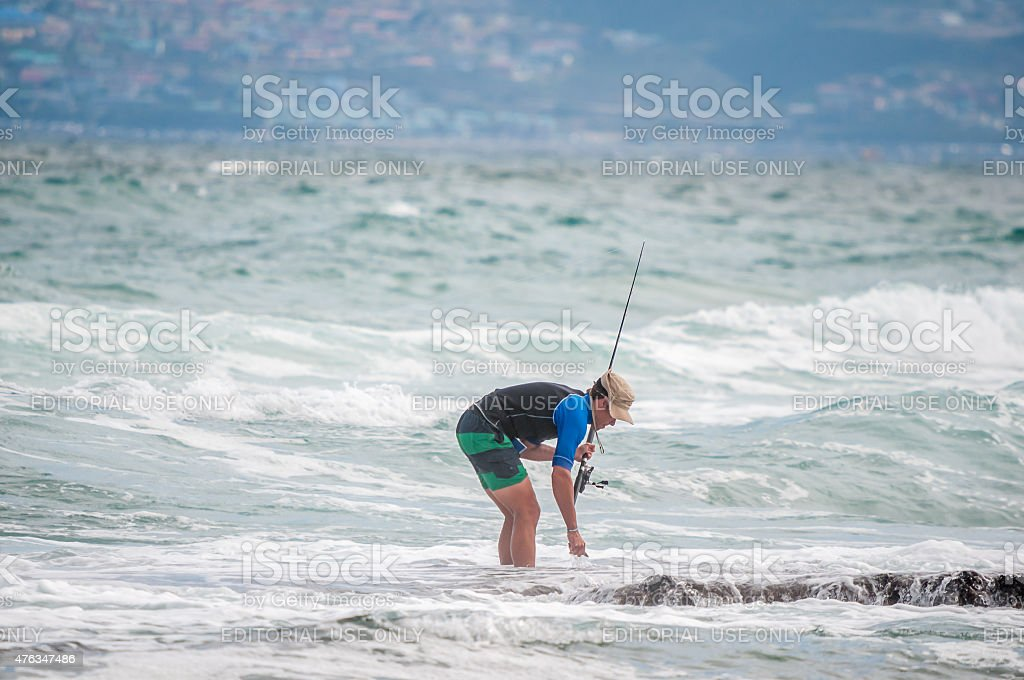 Angler at a beach in Reebok stock photo