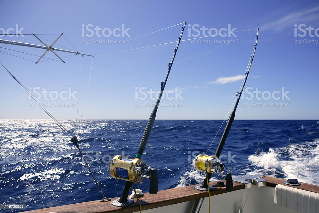 Angler boat on an ocean with two fishing rods royalty-free stock photo