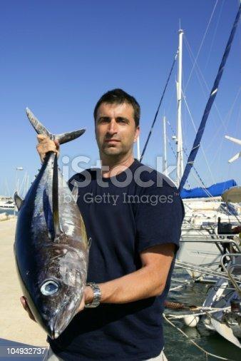 156872766istockphoto Angler fishing big game Albacore tuna on Mediterranean 104932737