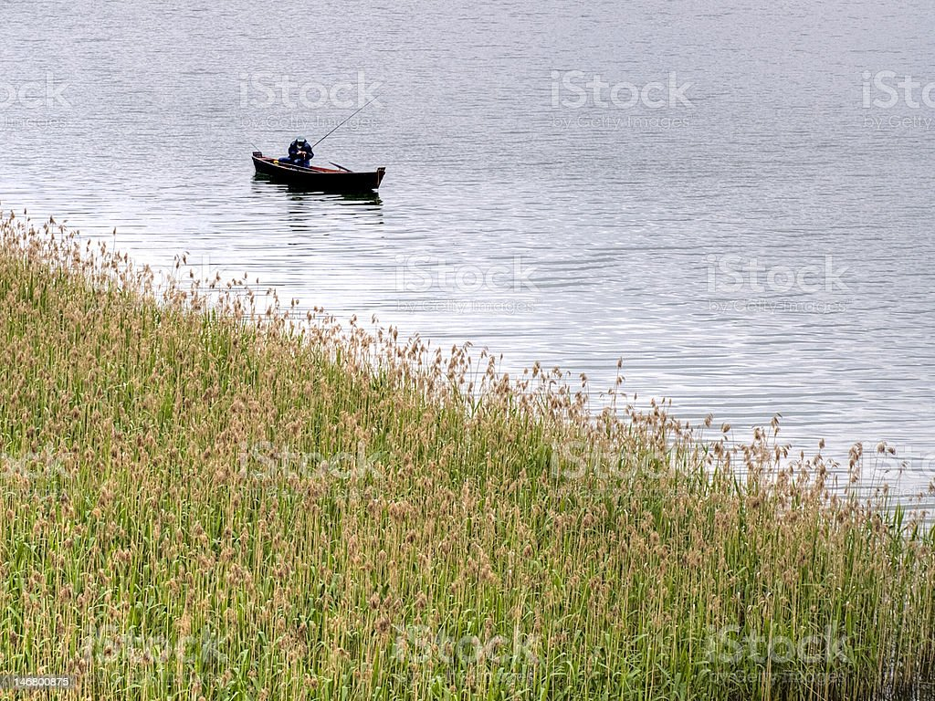 angler in a boat stock photo